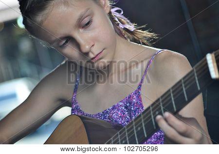 Teenage Girl Playing Guitar
