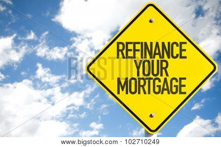 Refinance Your Mortgage sign with sky background