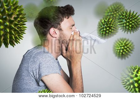 Close up side view of man blowing nose against grey vignette
