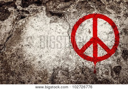 Red peace symbol graffiti on grunge cement wall - peace concept poster