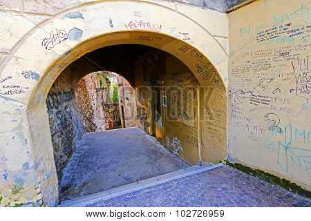 VERONA, ITALY - SEPTEMBER 2014 : A wall covered with street sign, graffiti in Verona, Italy on September 14, 2014. Photo taken on the way up to the Castel San Pietro on the hill of San Pietro.