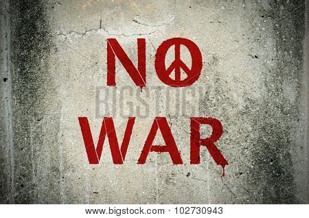 Red No War Message And Peace Symbol Graffiti On Grunge Ciment Wall