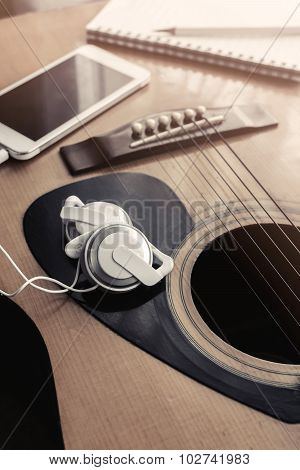 Close Up Of Earpiece With Cellphone On Guitar