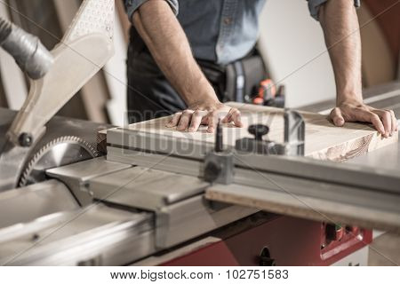 Carpenter Using Sawing Machine
