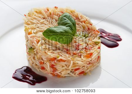 basmati rice on a white plate with basil