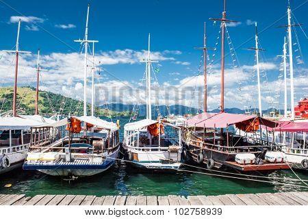Sailing boats on port of Angra dos Reis city in state of Rio de Janeiro. Brazil.