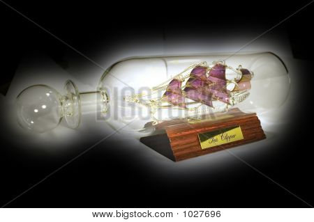 object on black - ship in the glass bottle poster