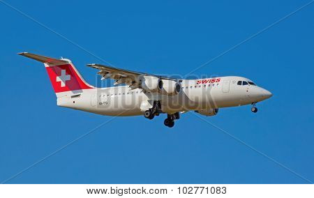 ZURICH - JULY 18: AVRO RJ100 landing in Zurich airport after short haul flight on July 18, 2015 in Zurich, Switzerland. Zurich airport is home port for Swiss Air and one of the biggest european hubs.