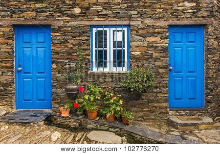 Detail of door in old stone house in a remote portuguese rural village