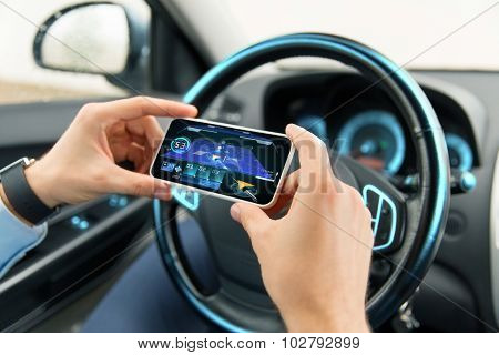 transport, business trip, technology and people concept - close up of male hands with navigation system on smartphone screen in car