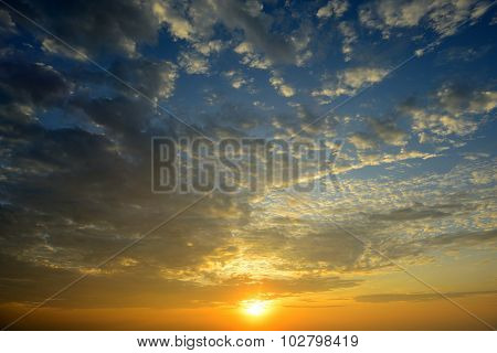 The beautiful sunrise and warm sky with cloud