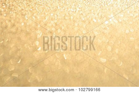 Abstract bright Golden Holiday Background bokeh effect