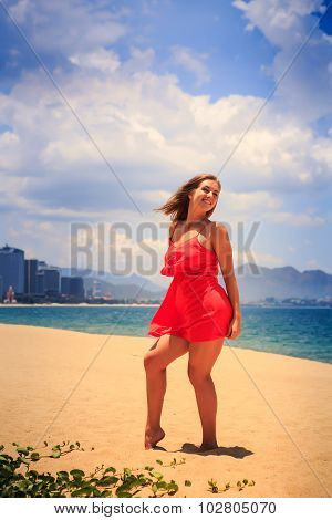 Blond Girl In Red Dances Barefoot On Sand Wind Shakes Long Hair