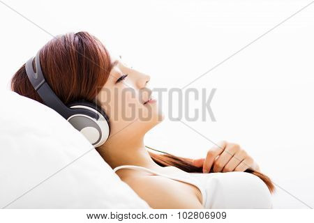 Relaxed Young Woman With Headphones Listening Music