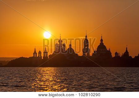 Monastery Silhouette Against The Setting Sun In Rostov