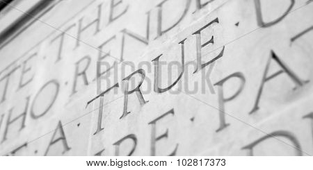 Word Carved in Stone Granite True