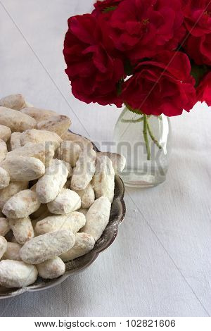 White Cookies And Vase With Red Roses
