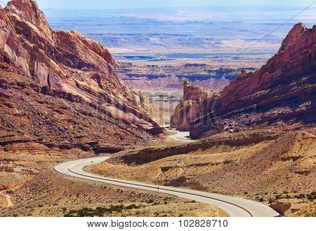 Panorama of Interstate 70 goes through Spotted Wolf Canyon through the San Rafael Reef in Utah, USA in spring poster