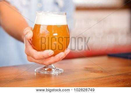 Skilled young barman is working in bar