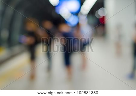 Blurred People At Train Station