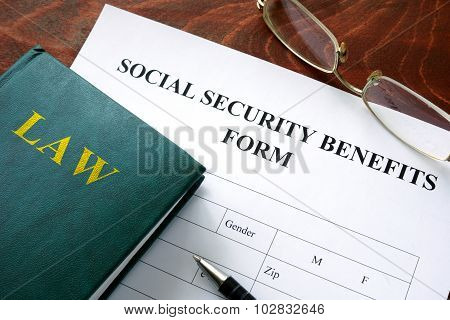 Social security benefits form on a wooden table. poster