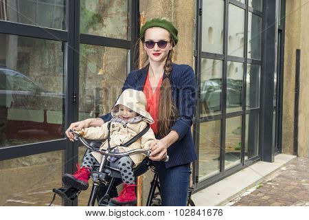 Moter And Baby Daughter On A Bicycle
