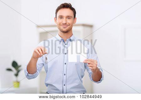 Nice realtor holding keys