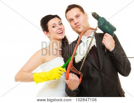 Housework concept. Humorous funny couple bride groom in domestic role sharing household chores. Isolated on white background. poster