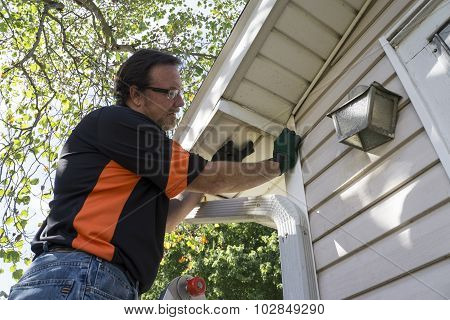 Contractor Popping Vinyl Siding Back In Place
