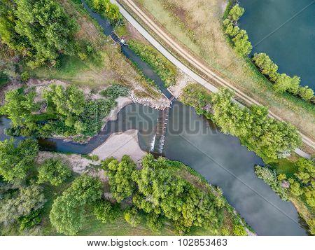 aerial view of the diversion dam providing water for farming - Cache la Poudre River near WIndsor, Colorado