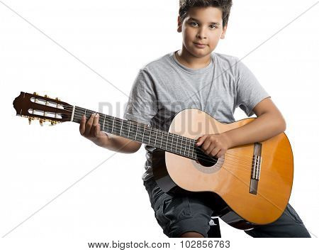Child playing classical guitar isolated on white background.