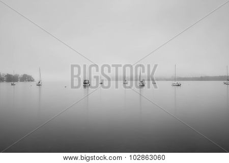 Sailing Boats Foggy Morning On Lake Windermere In Lake District In Black And White