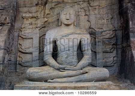 The Seated Buddha was carved out of a granite cliff at Gal Vihariya in Pollanaruwa Sri Lanka. It is part of one of the most important Buddhist shrines in the world and also a part of a UNESCO World Heritage Site. poster