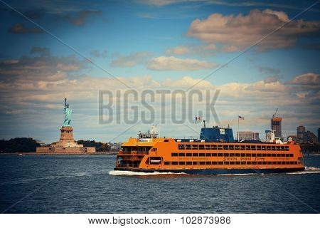 NEW YORK CITY, NY - JUL 11: Staten Island Ferry with Statue of Liberty on July 11, 2014 in New York City. It start service since 1905 and carries over 21 million passengers annually