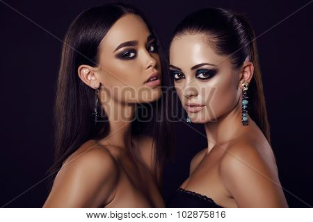 Sexy Girls With Dark Hair And Evening Makeup With Bijou