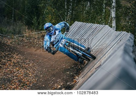 Cyclist riding a mountain bike downhill