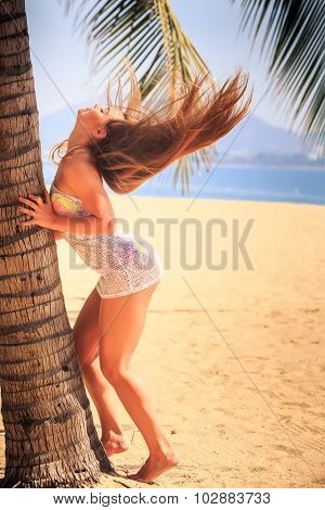Blonde Girl In Lace Touches Palm Wind Lifts Long Hair Upwards