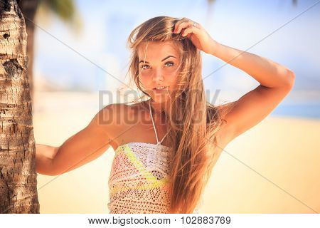 Portrait Of Blonde Grey-eyed Girl In Lace Touching Long Hair