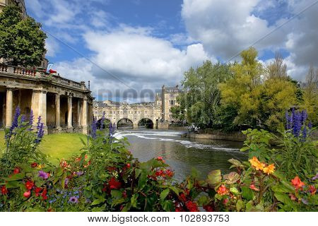 view of the Empire Hotel, by architect Charles Edward Davis and Pulteney Bridge over the River Avon in Bath, Somerset, England poster
