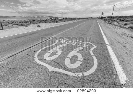 Old Route 66 desert pavement sign in black and white