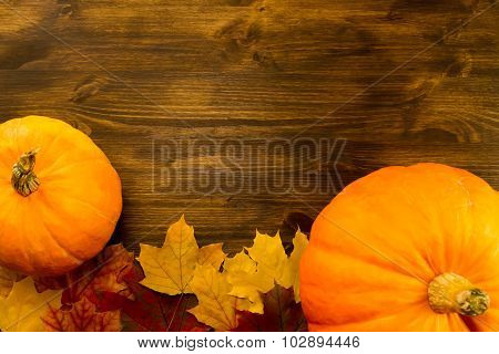 Yellow Ripe Pumpkin, Maple Leaves On Wooden Background. Thanksgiving, Autumn.