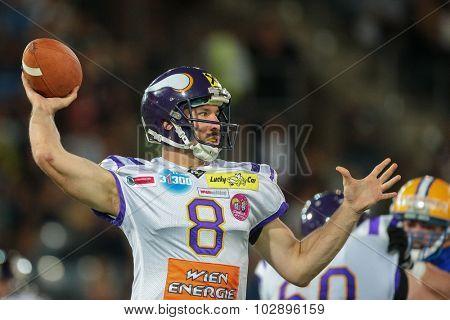 GRAZ, AUSTRIA - JUNE 27, 2014: QB Christoph Gross (#8 Vikings) passes the ball during an Austrian football league game.