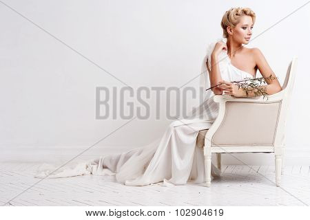 Beauty Woman With Wedding Hairstyle And Makeup. Bride Fashion. Jewelry And Beauty. Woman In White