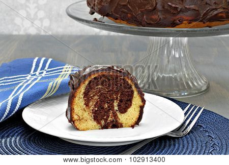 Swirled Chocolate And Vanilla Cake With Chocolate Frosting.