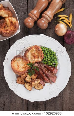 Traditional british sunday roast with yorkshire pudding, roasted potato and vegetables poster