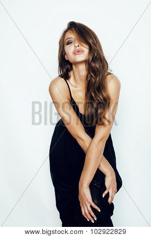 young brunette pretty woman in black dress posing on white background with make up erotica