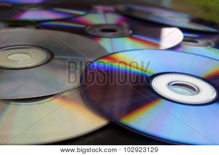 isolated, cd, white, disk, computer, dvd, rom, data, technology, storage, music, compact, color, digital, image, backgrounds, software, on, case, compartment, refraction, generated, circle, plastic, rainbow, blank, digitally, megabytes, sound, bytes, back poster