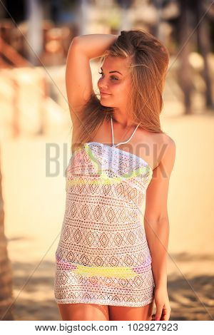Portrait Of Blonde Girl In Lace Smiling Against Defocused Palms