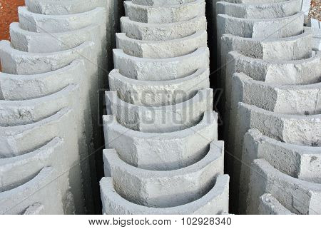 SELANGOR, MALAYSIA - APRIL, 2014: V-Shape drain is a surface water drainage drain to discharge rain water to nearest channel. It was made from precast concrete from factory. It was constructed by workers at the construction site. poster