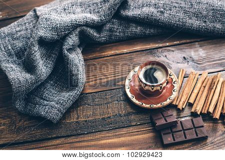 Knitting, coffee and blanket on brown wooden table, top view point